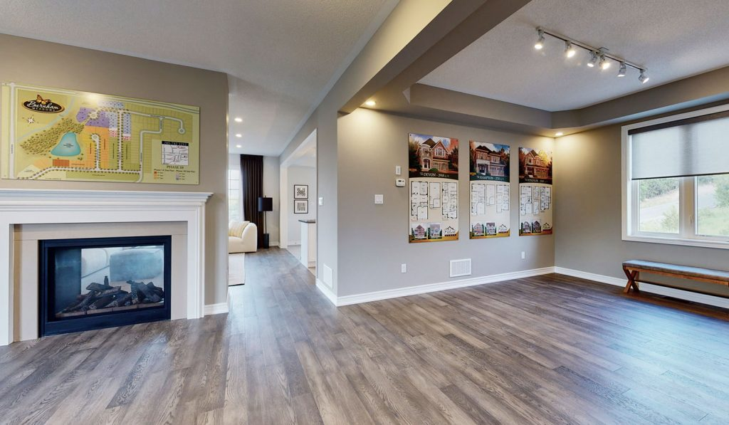 Picture Homes Model Home - Fire Place and Hallway Leading to Kitchen and Family Living Room