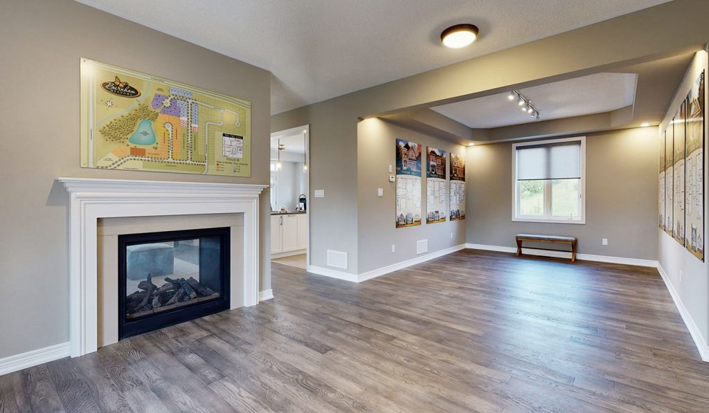 Picture Homes Model Home - Open Concept Living Room with Cozy Fire Place
