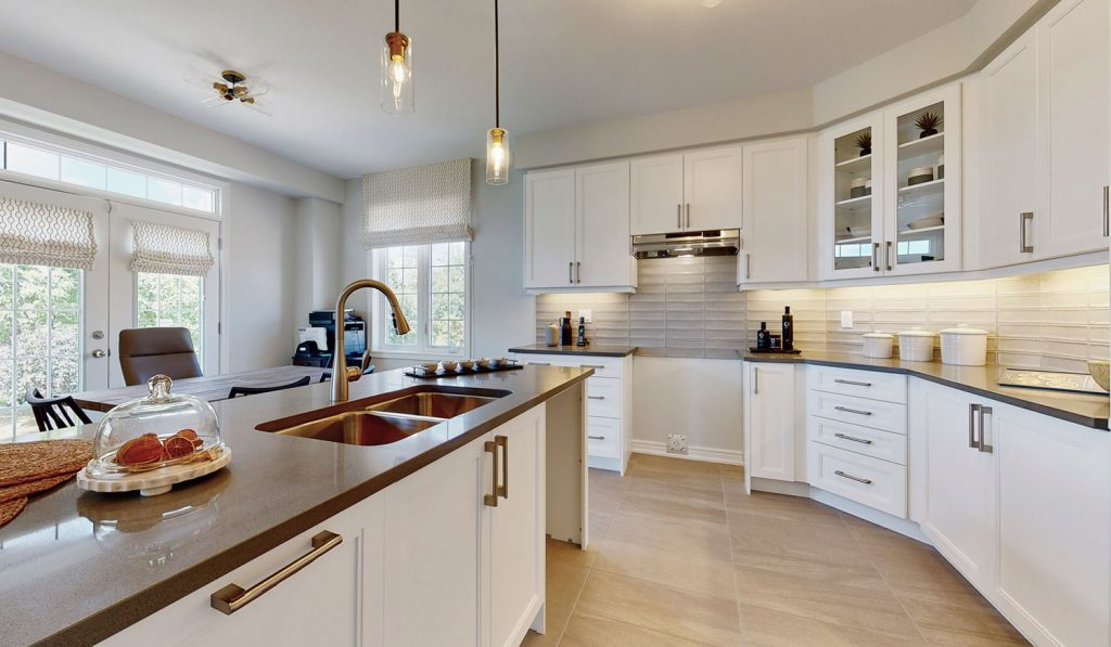 Picture Homes Model Home - Kitchen Cupboards and Drawers beside Island with Double Sink