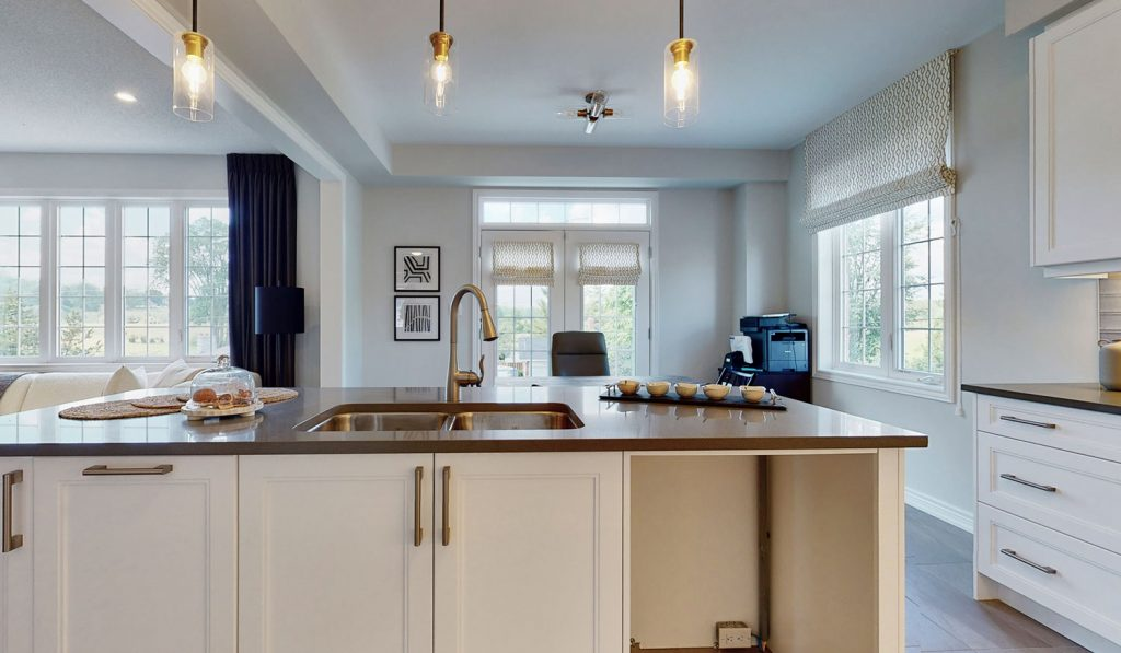 Picture Homes Model Home - Kitchen Light Fixtures Hanging Above Sink and Table