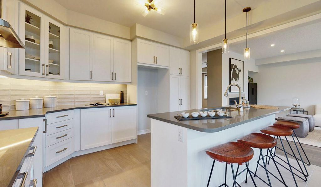 Picture Homes Model Home - Beautiful Kitchen with Island, Barstools, and Standard Finishings