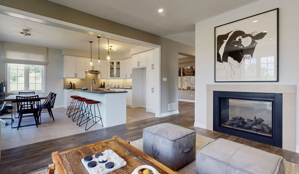 Picture Homes Model Home - Fire Place in Family Living Room Beside Kitchen Area