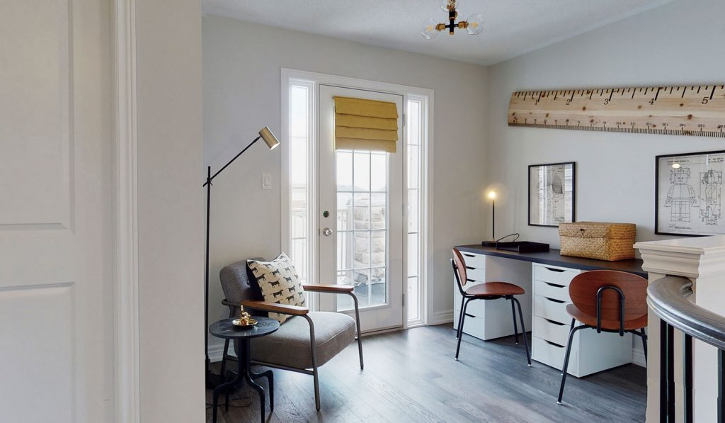 Picture Homes Model Home - Office Chair and Lamp Beside Double Work Desk in Front of Balcony Doors