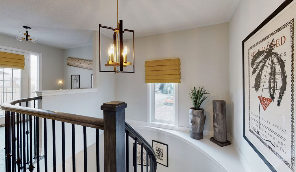 Picture Homes Model Home - Light Fixture Hanging Above Staircase With Artwork on the Ledge
