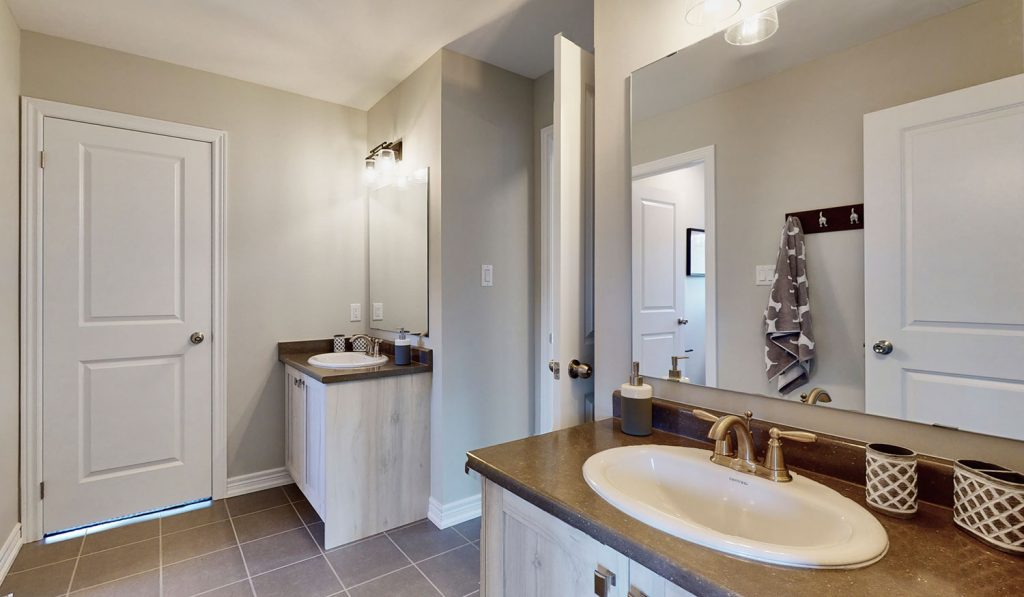 Picture Homes Model Home - Ensuite Washroom with Two Sinks and Large Mirrors