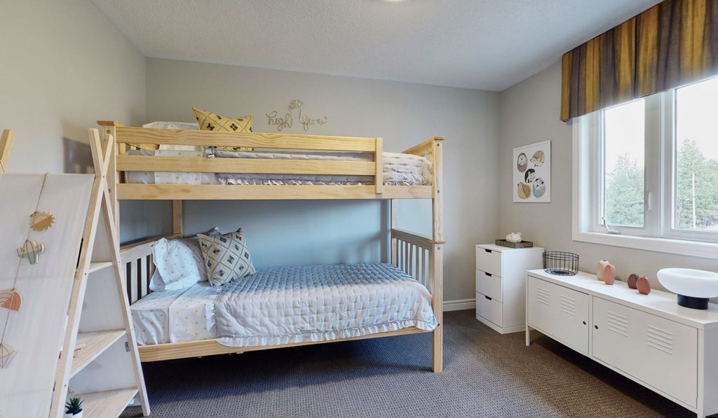 Picture Homes Model Home - Bunk Beds and Small Dresser in Second Bedroom