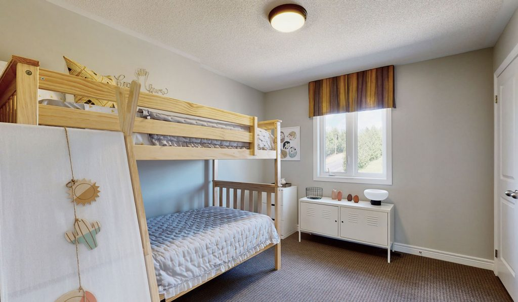 Picture Homes Model Home - Bunk Beds and Dresser in Childs Bedroom