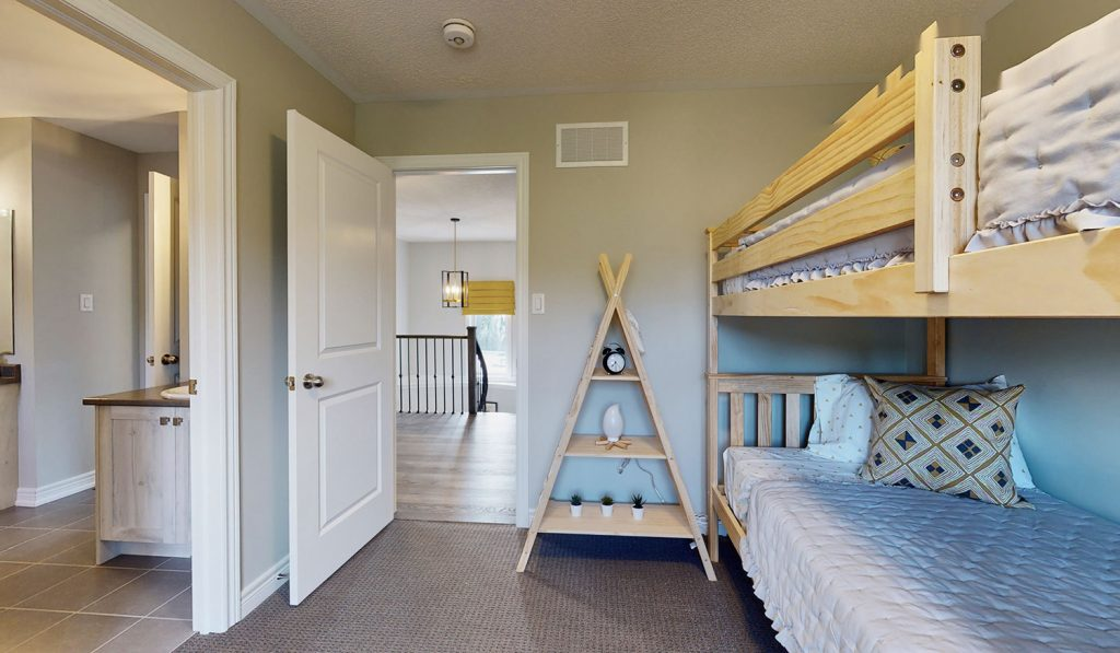 Picture Homes Model Home - Bedroom With Bunk Beds and Ensuite Connecting Washroom