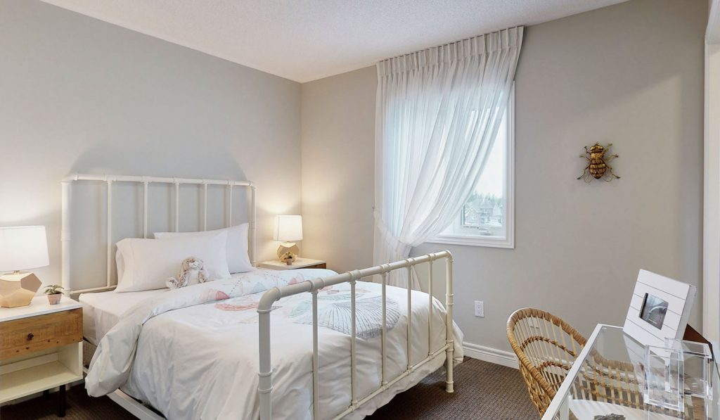 Picture Homes Model Home - Childs Bedroom with White Bed Beside the Window