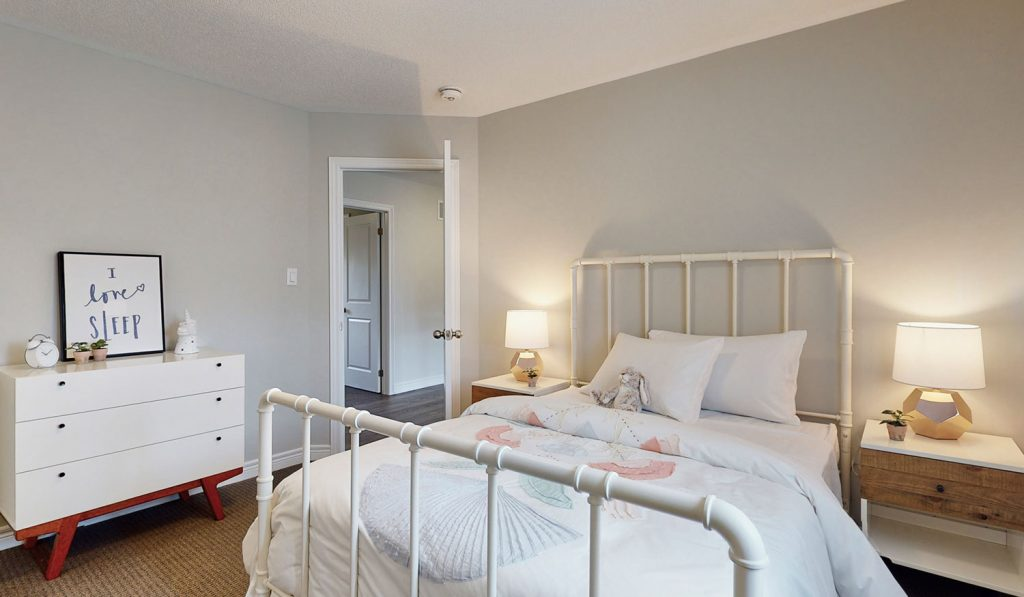 Picture Homes Model Home - Childs Bedroom with White Sheets on Double Bed with Dresser and Nightstand