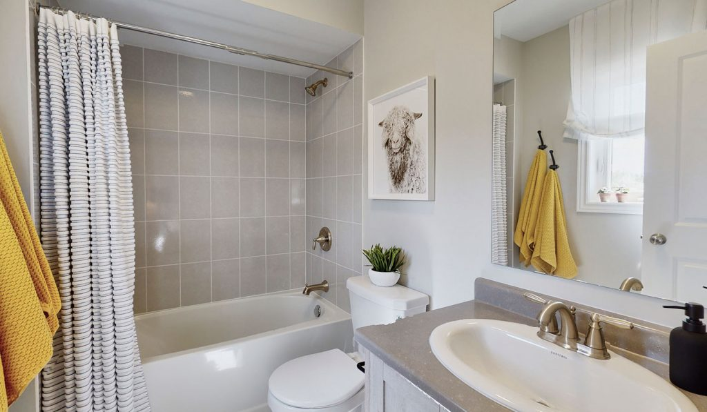Picture Homes Model Home - 4 Piece Bathroom with Standard Finishings, Bathtub Shower, Toilet, and Sink