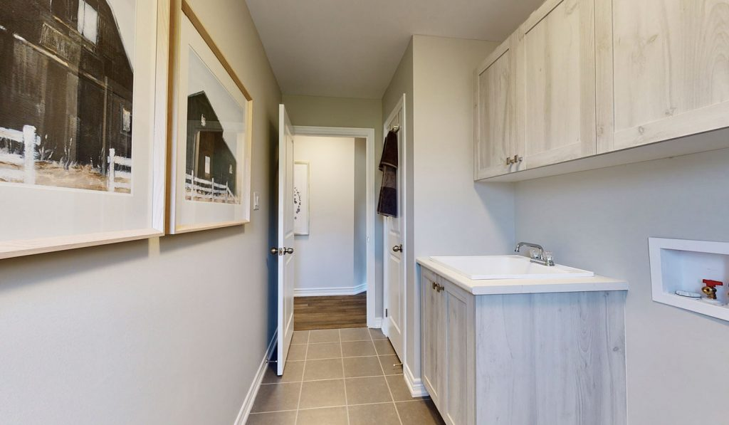 Picture Homes Model Home - Laundry Room with Sink and Storage Closet