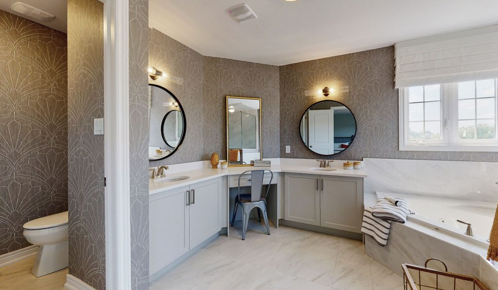 Picture Homes Model Home - Bathroom With Double Sink and Mirrors, Bathtub and Toilet