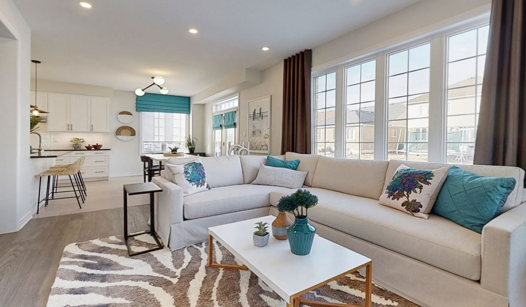 Picture Homes The Hampton Model Home - Family Room Living Space with Large Windows and Natural Light