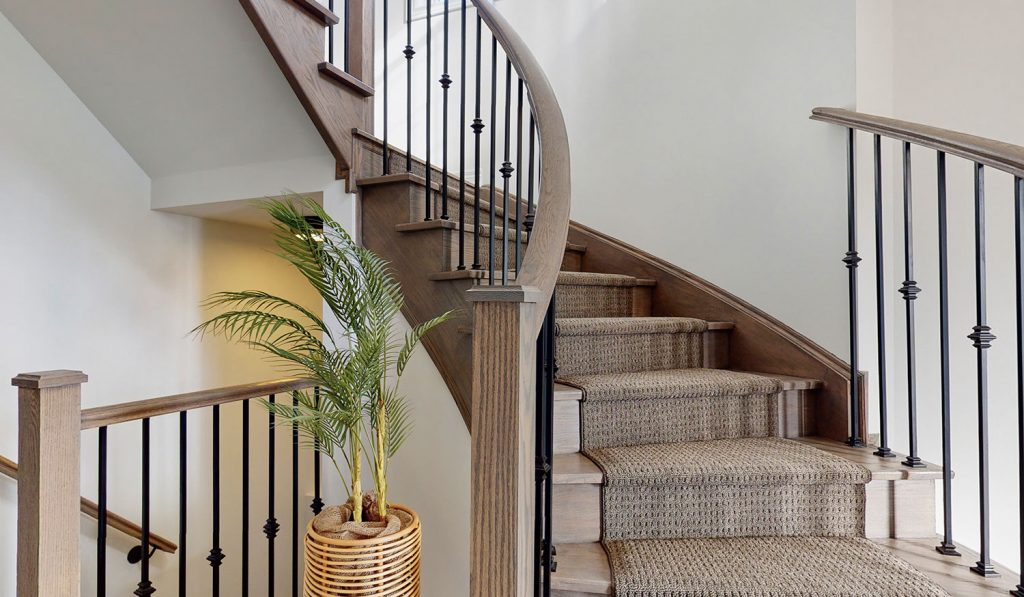 Picture Homes The Hampton Model Home - Hardwood and Carpet Staircase Leading to Second Floor