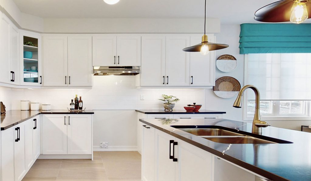 Picture Homes The Hampton Model Home - Kitchen Cabinetry and Granite Countertops