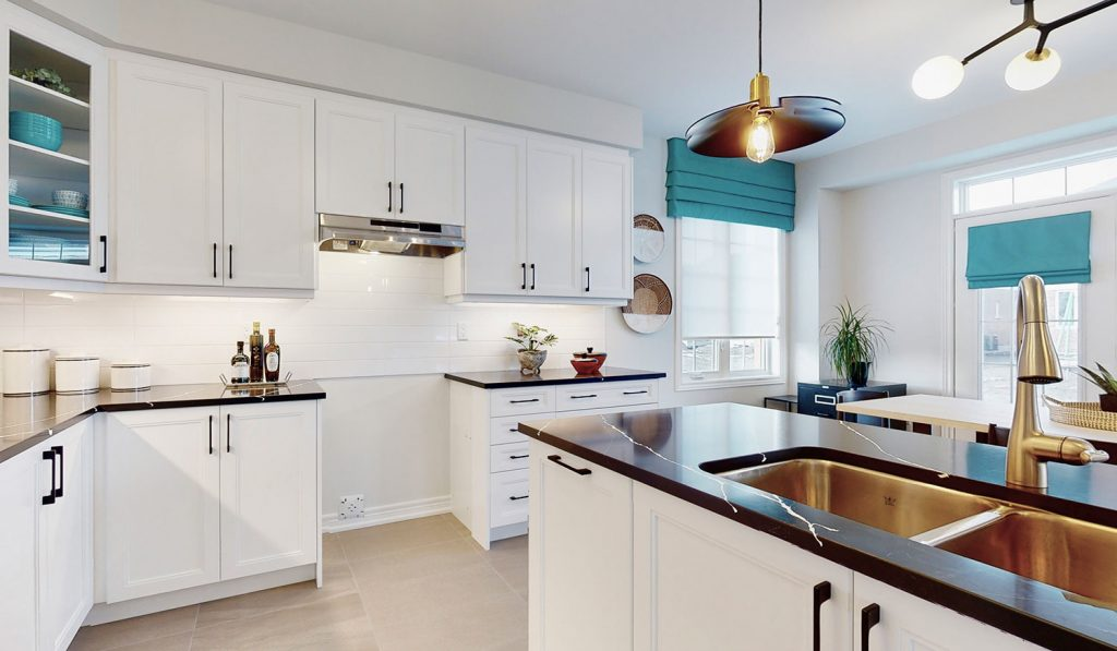 Picture Homes The Hampton Model Home - Kitchen Cabinets and Island with Stainless Steel Sink and Granite Countertops