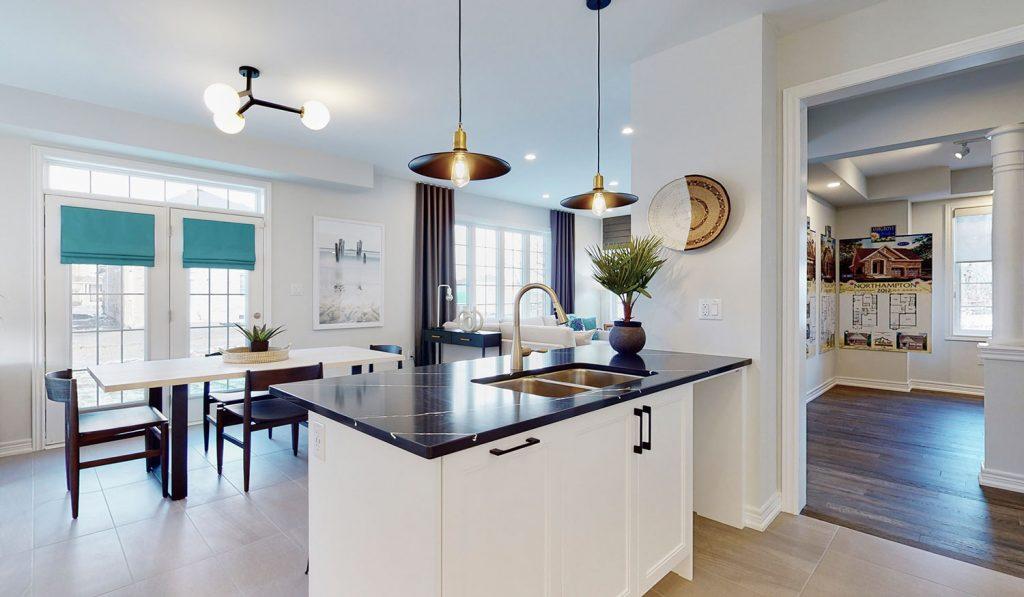 Picture Homes The Hampton Model Home - Kitchen Island with Granite Countertop