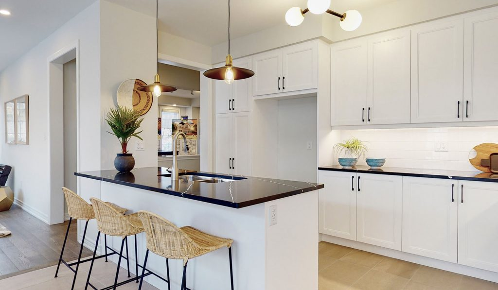 Picture Homes The Hampton Model Home - Kitchen Island with Seating in Front of Cabinetry