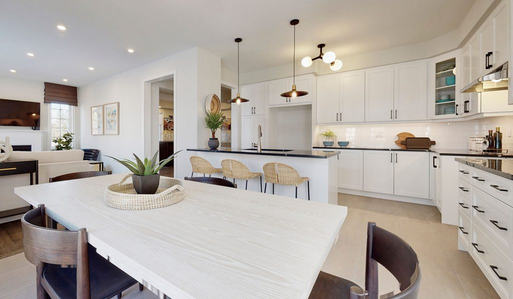 Picture Homes The Hampton Model Home - Kitchen Interior, Cabinets, and Dining with Island