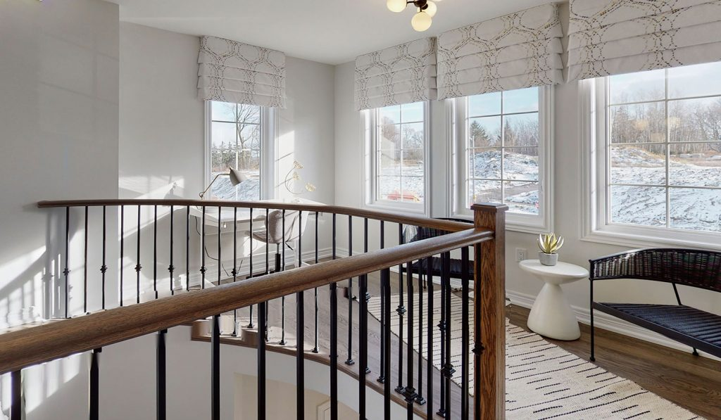 Picture Homes The Hampton Model Home - Staircase and Upstairs Hallway Windows Looking Outside