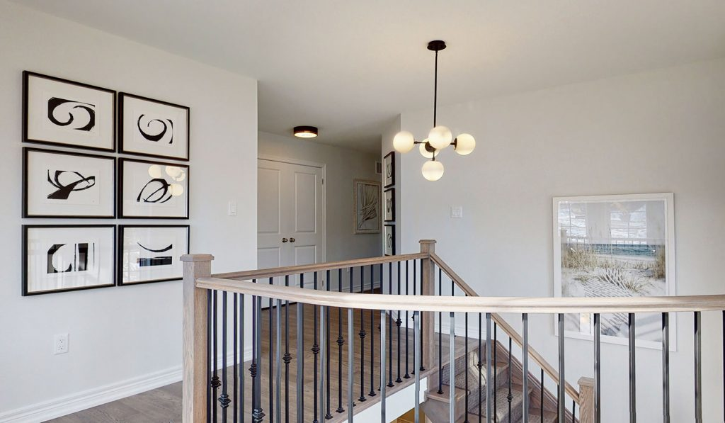 Picture Homes The Hampton Model Home - Upstairs Hallway and Staircase on Second Floor