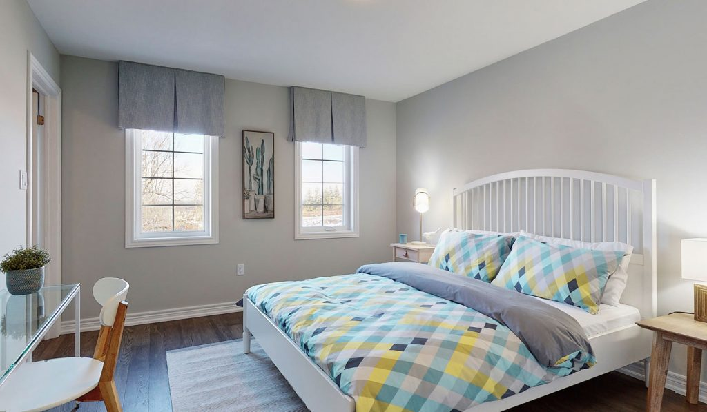 Picture Homes The Hampton Model Home - Double Bed with Bedframe and Lots of Natural Light in Upstairs Bedroom
