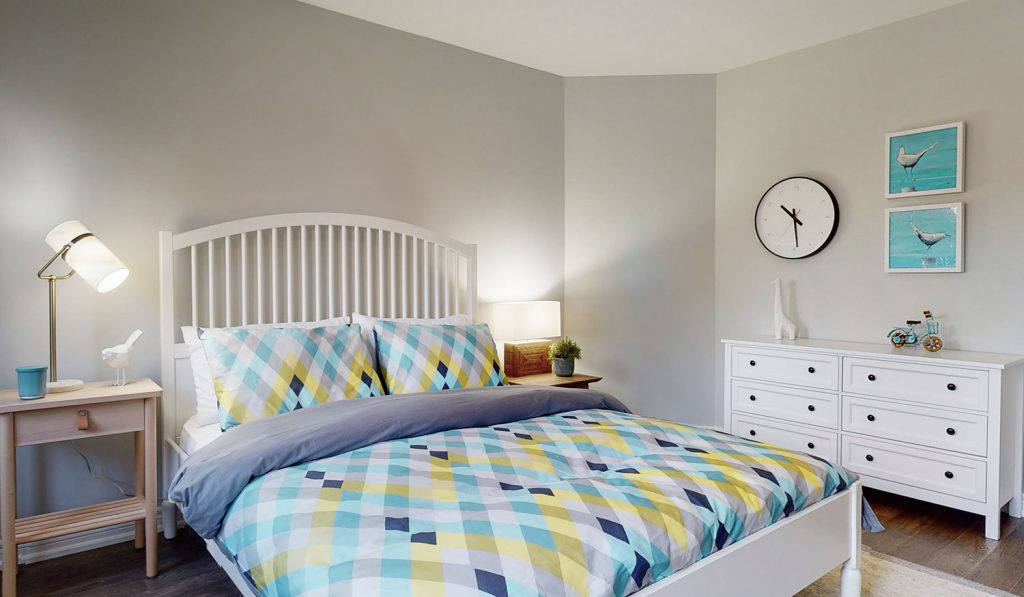 Picture Homes The Hampton Model Home - Double Bed and Dresser in Bedroom