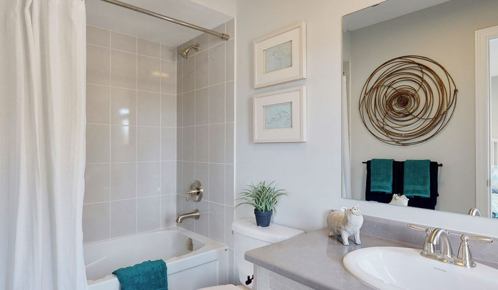Picture Homes The Hampton Model Home - Bathroom With Shower, Bathtub, Toilet, and Sink