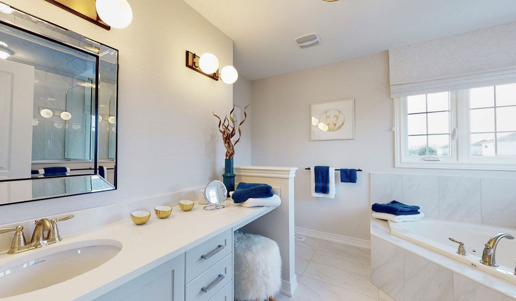 Picture Homes The Hampton Model Home - Ensuite Bathroom with Tiled Floors and Natural Light