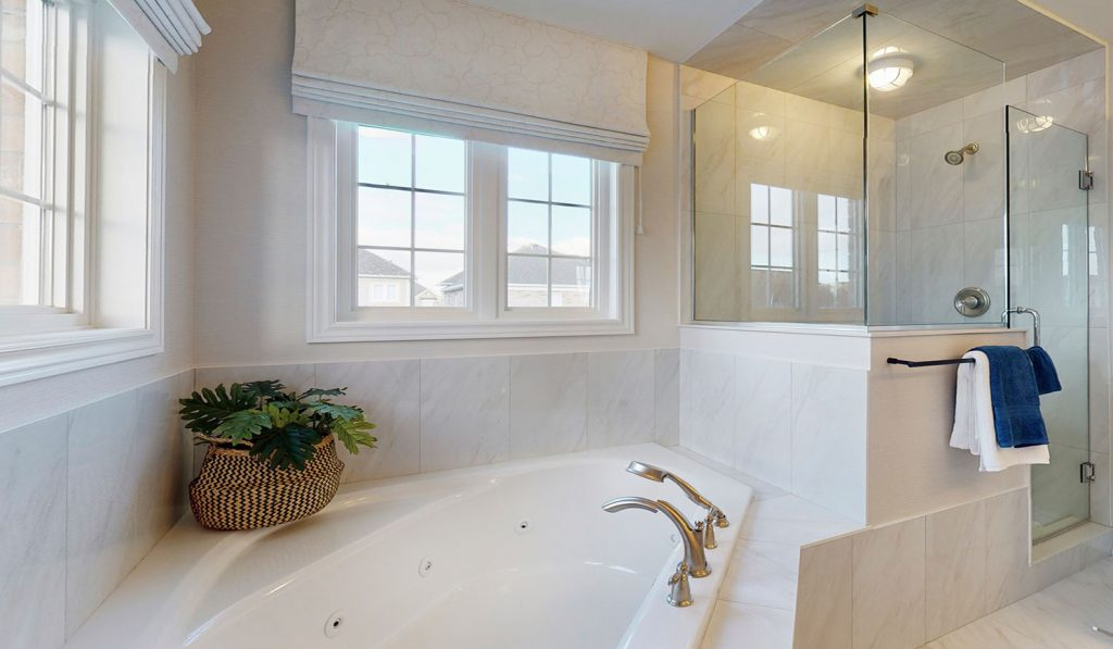 Picture Homes The Hampton Model Home - Ensuite Bathroom with Large Bathtub and Walk in Shower