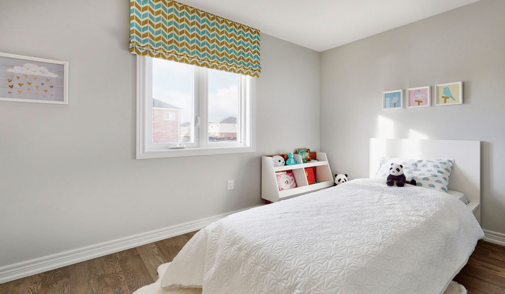 Picture Homes The Hampton Model Home - Bedroom With Natural Light and White Walls