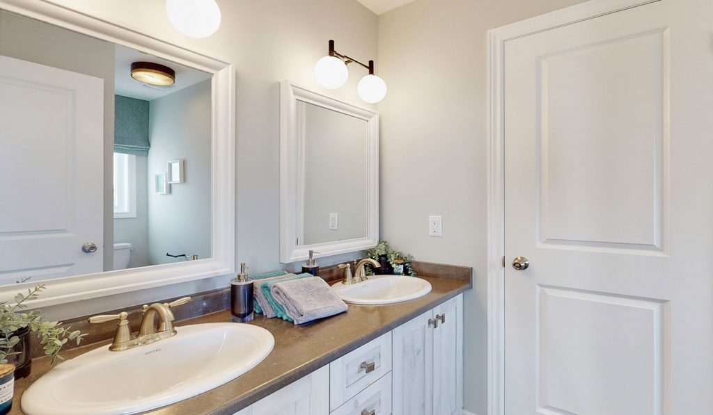 Picture Homes The Hampton Model Home - Two Sinks and Two Mirrors in Shared Bathroom
