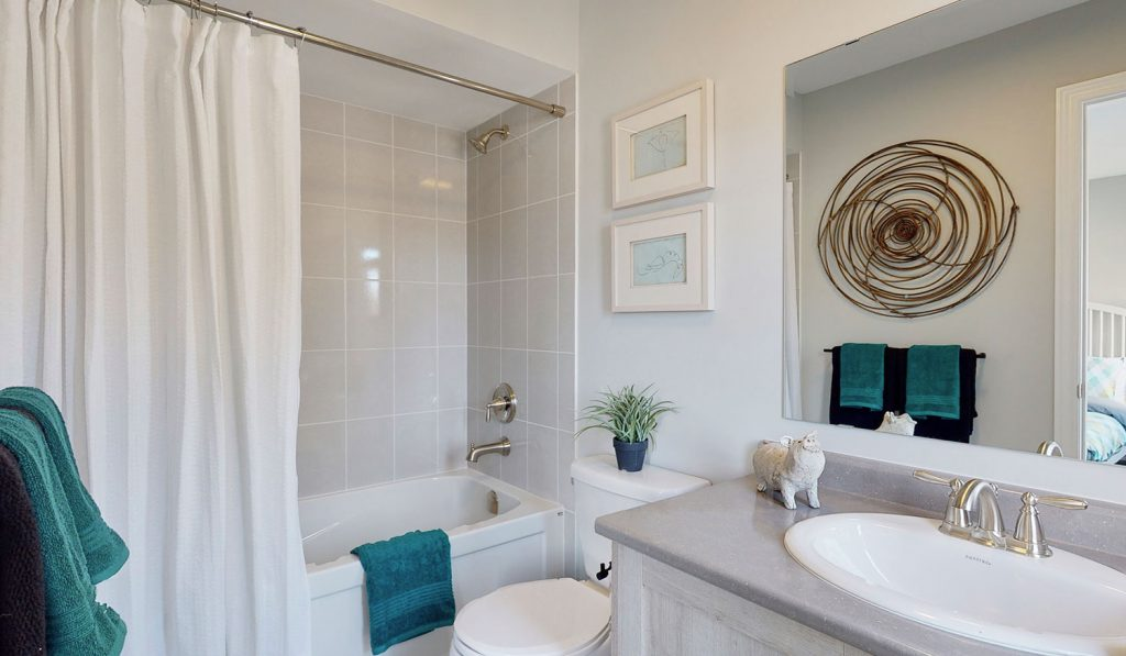 Picture Homes The Hampton Model Home - Full Bathroom With Bathtub Shower, Toilet, and Sink