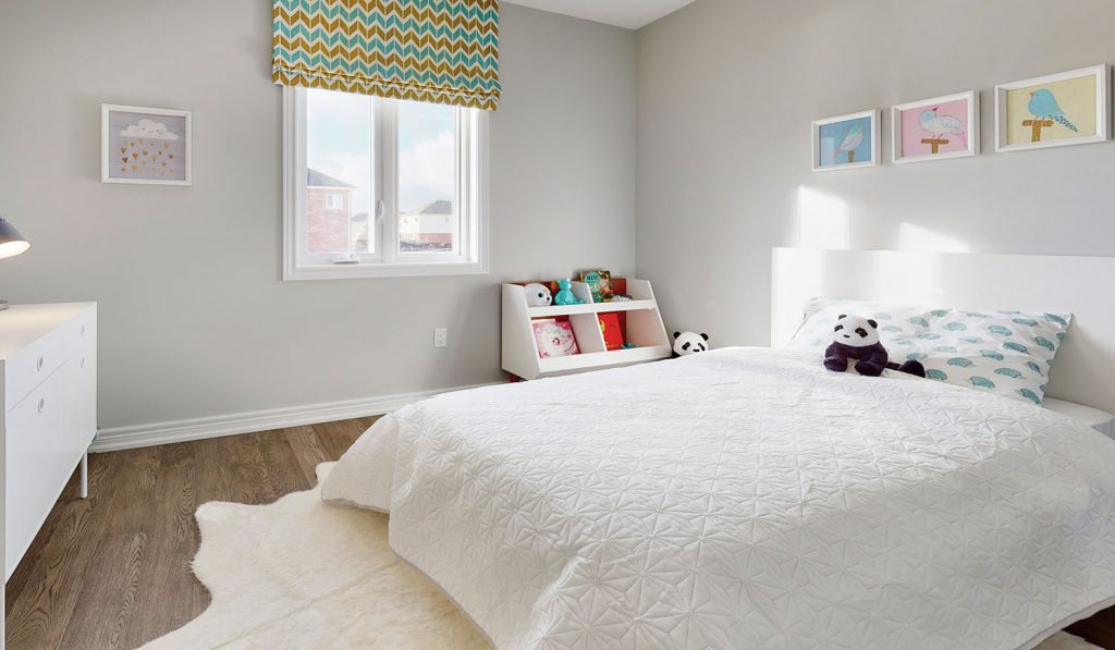 Picture Homes The Hampton Model Home - Childs Bedroom with Artwork on Walls