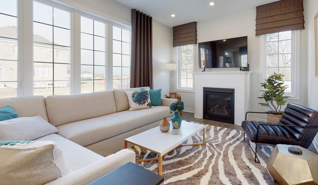 Picture Homes The Hampton Model Home - Main Living Room Couch, Coffee Table and Chair